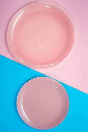Two pink plates on a pink background. glass plates for eating. New, beautiful dishes. Breakfast for two