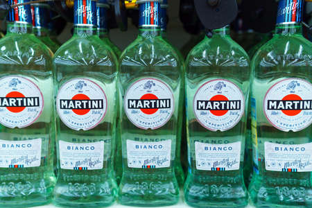 Tyumen, Russia-may 04, 2020: Bottles of vermouth martini stand on a supermarket shelf. Sale of alcoholic beverages Редакционное