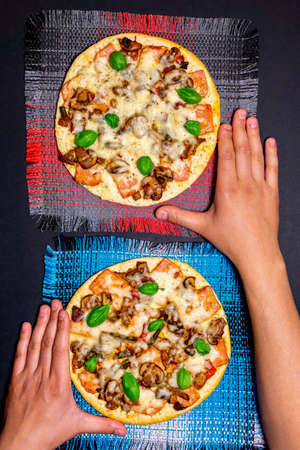 Hands taking pizza. Topview. food order rating. vertical photo Фото со стока