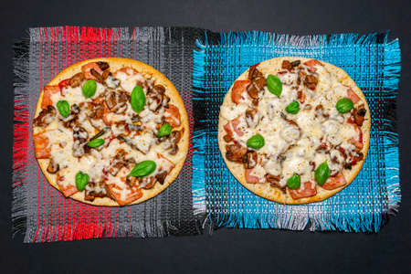 tasty delicious rustic homemade american pizza with mushrooms, ham, Basil and mozzarella cheese on black table. the view from the top, flat lay Фото со стока