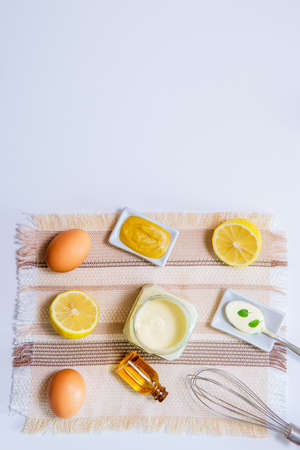 mayonnaise eg oil lemon mustard and wire whisk. top view copyspace Imagens