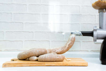 homemade sausage links with meat grinder. Sausage allowed with keto diet. 免版税图像 - 151881947