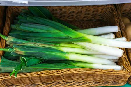 Leek stalks, green vegetables, local produce market. 免版税图像