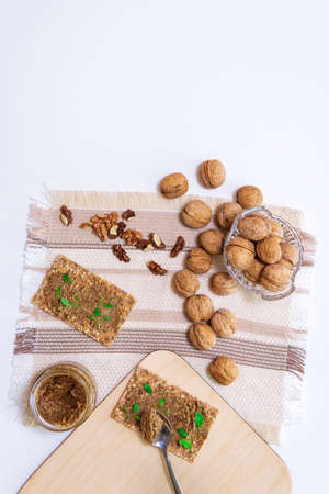 organic walnut butter and fresh nuts on table. Copy space for text. top view flat lay 免版税图像 - 151858058