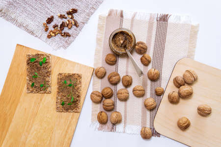 walnuts and nut butter on bread healthy snacks top view. flat lay 免版税图像