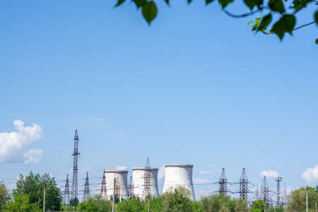 Big power plant with pipes, bright Sunny day blue sky, place for text