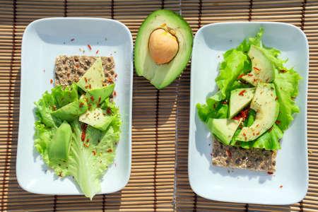 crispbread with salad and avocado top view. Healthy healthy breakfast