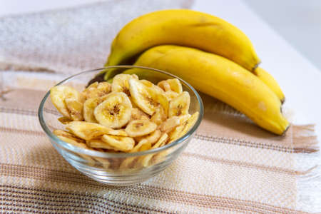 banana chips sweet dried food snack delicacy. organic healthy eating raw
