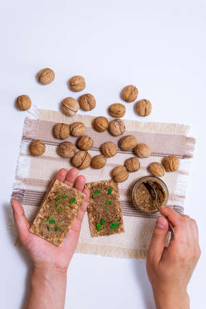 organic walnut butter and fresh nuts on table. Copy space for text. top view flat lay