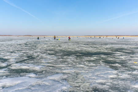natural winter background, a fisherman on the ice. fishing in the winter, the place for copyspace