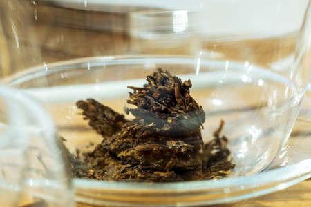 black Puer tea close-up, macro. dry tea, tea ceremony Reklamní fotografie
