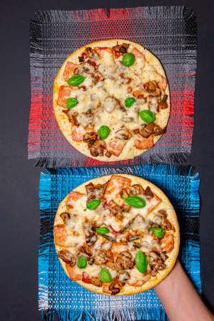 Hands taking pizza. Topview. food order rating. vertical photo Reklamní fotografie