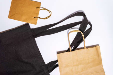 paper shopping bags on white background. Eco-friendly packaging. Shopping. ECO-friendly, reusable and Zero waste concept. 写真素材