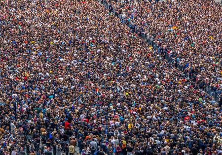 large crowd of spectators having fun at stadium selective focus, defocus
