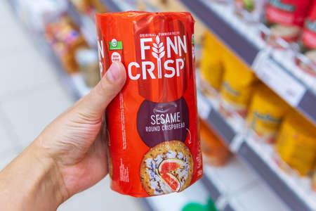 Tyumen, Russia-August 01, 2020: Finn Crisp thin sourdough rye bread made by Vaasan Oy. Vaasan Oy is the largest thin crisp producer in the world.