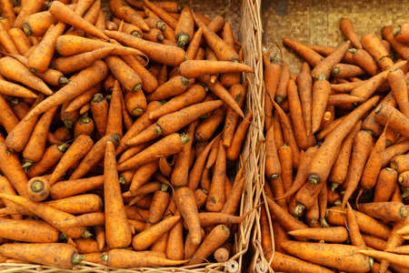 Local produce carrots are displayed for sale at the market. Organic and bio fresh healthy eating concept. 写真素材