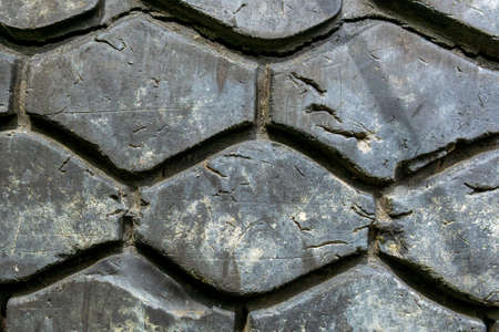car tire in the tire repair shop. Old tire in auto repair service. background texture