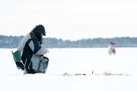 winter fishing. Ice fishing. Leisure. Winter landscape. Fisherman on ice lifestyle 写真素材