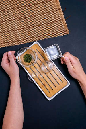 green tea for the ceremony on a dark background, top view, free space vertical photo flat lay 写真素材
