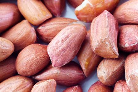 raw peanut grain close-up macro background texture. selective focus 写真素材