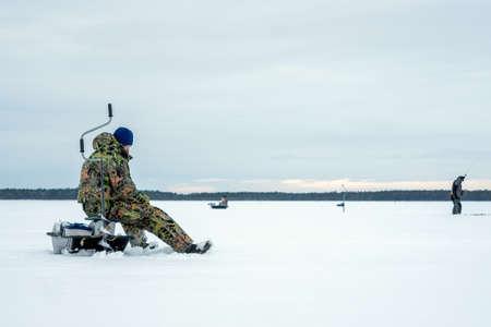 winter fishing. Ice fishing. Leisure. Winter landscape. Fisherman on ice lifestyle Imagens