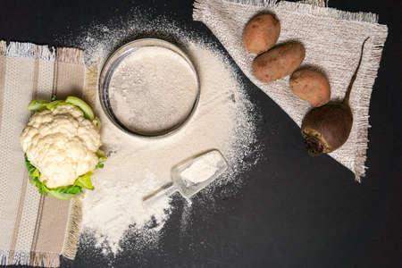 flour vegetables gluten free potatoes cauliflower beetroot top view flat lay 免版税图像