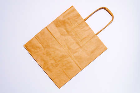 Empty Kraft Paper Bags on white background. Packaging template mockup. Top view package