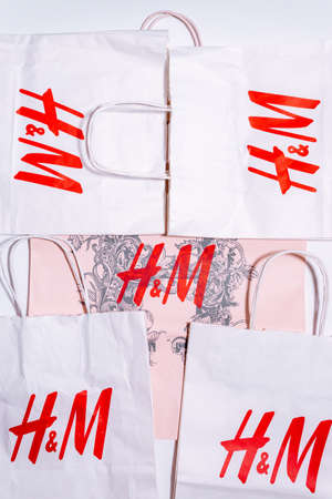 Tyumen, Russia-August 01, 2020: H and M shopping bag. H and M logo on a white package top view Editorial