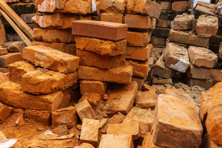 piles of brick, Red brick for building houses. Many used wall bricks laid on a pile