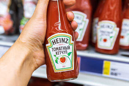 Tyumen, Russia-July 12, 2020: Heinz tomato ketchup at the hypermarket in Russia. manufactured by HJ Heinz Company