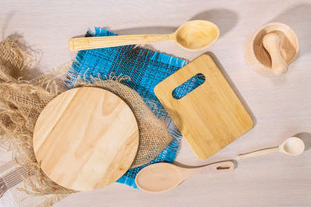 light wooden background, wooden Cutlery - a wooden spoon and cutting boards. top view flat lay