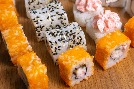 japanese sushi food. Maki ands rolls with tuna. sushi roll, uramaki, hosomaki and nigiri.