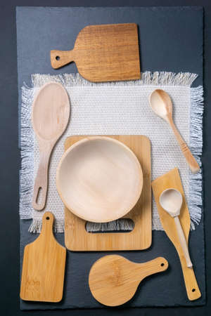 wooden kitchen appliances spoons, cutting boards. the view from the top. vertical photo