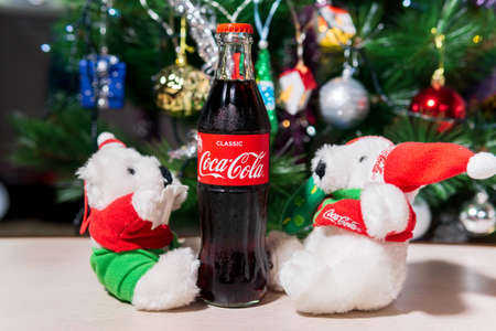 Tyumen, Russia-October 25, 2020: Classic bottle of Coca-Cola at Christmas or new year.