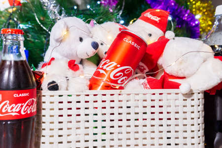 Tyumen, Russia-October 25, 2020: aluminum can of coca cola at christmas background and white bear toys.