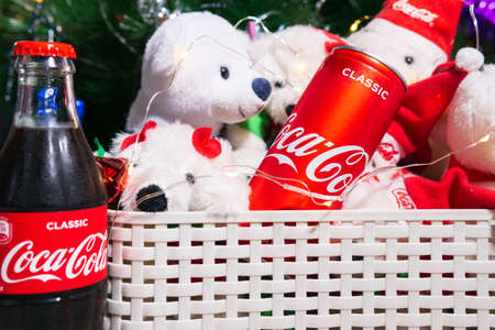 Tyumen, Russia-October 25, 2020: glass bottle of Coca Cola for new year, Christmas. Christmas tree with bears