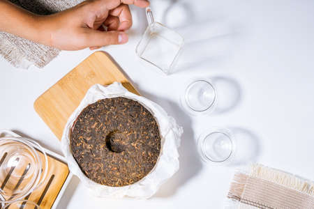 Black tea shu puerh. Top view, copy space. Food background.
