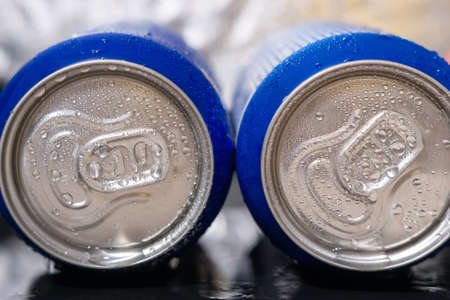 cans with soda Condensate, water drops on two cans with a drink