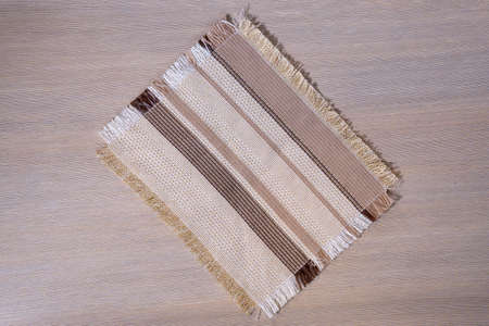 Kitchen napkin on a wooden table. Top view of the napkin. copy space. 免版税图像