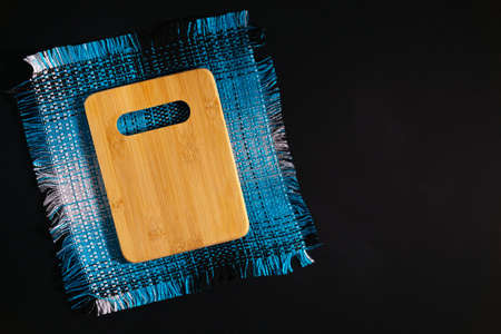 Cutting Board over a towel on a wooden kitchen table. The view from the top. space for copying text