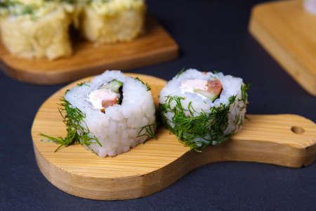 Sushi wooden chopsticks on table. Japanese food. Sushi Set. Variety of rolls.