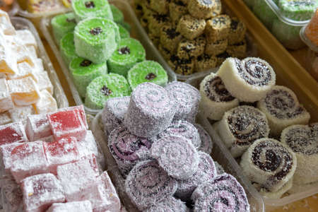 Turkish delight with whole nuts, traditional feast treat. selling sweets in the Bazaar