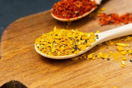 spices on dark vintage background. Healthy eating and cooking concept. Dark rustic style.
