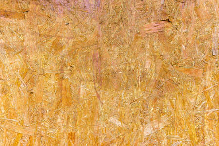 pressed wooden panel background, seamless texture of oriented strand board - OSB wood 免版税图像