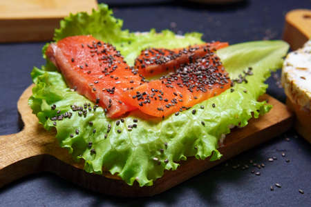 Super food protein toast crusty bread with salmon, cream cheese salad and Chia seeds
