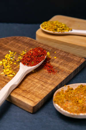 seasonings and spices on a stone black background. The view from the top. flat lay 免版税图像