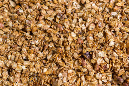 granola with nuts and mango raisins, Chia seeds. Food for Breakfast. Food background, granule texture.