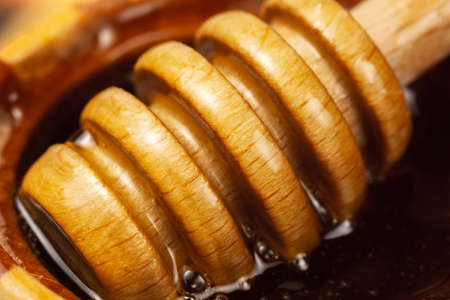 Honey in a wooden bowl. Close-up macro. Healthy organic honey. selective focus