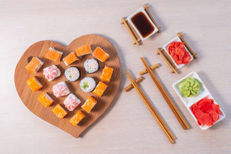 sushi rolls in the shape of a heart. the view from the top. concept of Valentines day, love