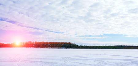 frozen lake in winter at sunset. Winter landscape Stok Fotoğraf